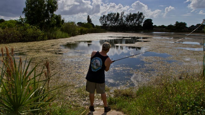 Zack Hudson, of Cape Coral, casts a line while fishing for bass Wednesday afternoon at a man made pond which used to serve as a water hazard for the now defunct The Golf Course in Cape Coral.