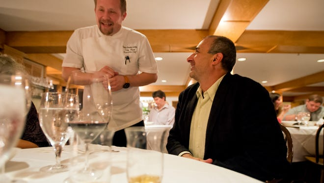 "Avery Rifkin, chef/co-owner of Stone Soup in Burlington, chats it up with executive chef Cody Vasek at Trapp Family Lodge in Stowe. Vasek visited our table at the end of the meal. ""Thank you guys for coming,"" he said. ""Cheers."""