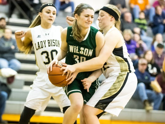Junior Emma Harrison, center, has played tough off the bench this season for Wilson Memorial.