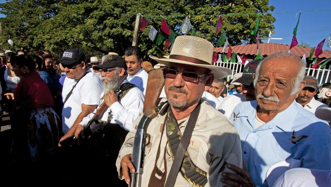 Hipolito Mora, leader of the self-protection militia, walks in La Ruana community, state of Michoacan, Mexico, on February 24, 2014.