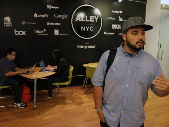Abran Maldonado of Long Branch, co-founder of the startup company NuSkool, tours the Cafe Lounge at Alley NYC, his workspace in New York City.