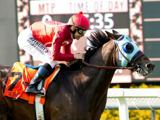 In a photo provided by Benoit Photo, Si Sage and jockey Mike Smith win the Grade II, $200,000 Charles Whittingham Stakes horse race, Sunday, May 29, 2016, at Santa Anita in Arcadia, Calif. (Benoit Photo via AP)
