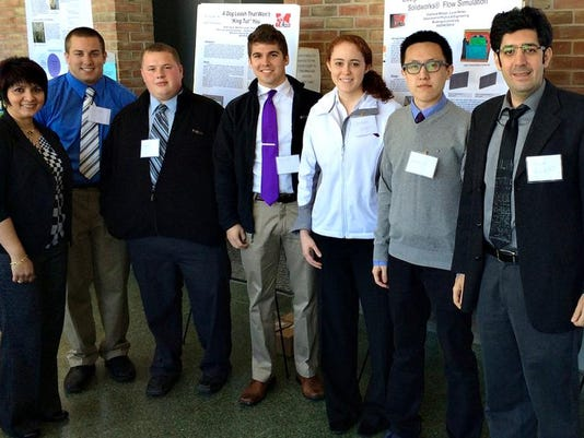 MUSK UNIV ENGINEERING STUDENTS  PRESENT AT CONFERENCE.jpg