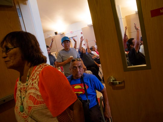 Community members leave a Northern Navajo Agency Council meeting as they vote to enter into executive session Thursday at the San Juan Chapter house in Lower Fruitland.