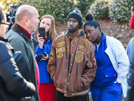 Alston Drummond, 28, and his wife, Shekinah Drummond, 27, who's apartment was one that was damaged in an early morning fire at the Plantations at Haywood Apartments off Haywood Road in Greenville listen as Greenville Police Chief Ken Miller gives an update on Friday, March 9, 2018. The couple's
