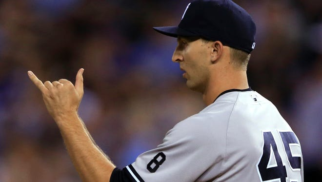 New York Yankees relief pitcher Chasen Shreve checks with infielders after walking a Kansas City Royals batter during the seventh inning of a baseball game at Kauffman Stadium in Kansas City, Mo., Wednesday, Aug. 31, 2016.