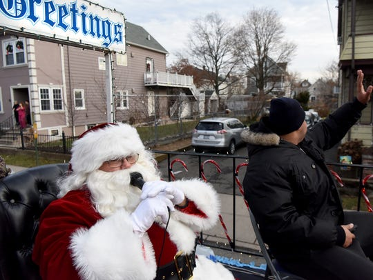 Santa, played by Patrick Doremus, rode on a float winding