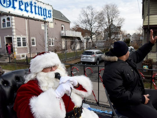 Santa, played by Patrick Doremus, rode on a float winding through the streets of Clifton on Christmas Eve bringing holiday cheer.