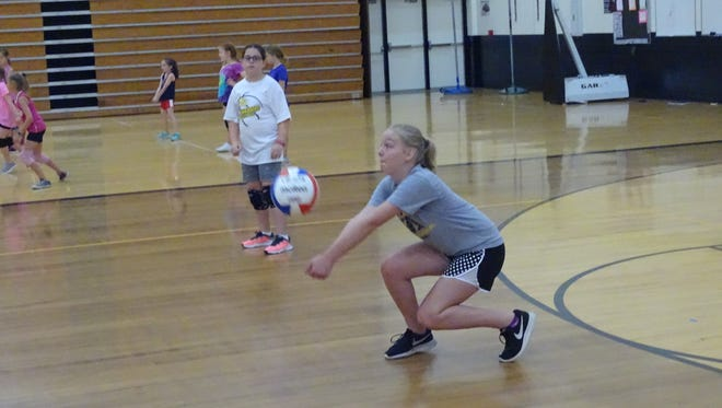 Sixth-grader Gracie Copley practices passing Monday during Watkins Memorial's youth volleyball camp.