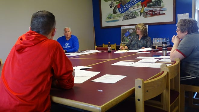 Three Lakewood board members and district treasurer Glenna Plaisted met Sunday to discuss to discuss a plan to replace Bill Gulick, who resigned April 19.