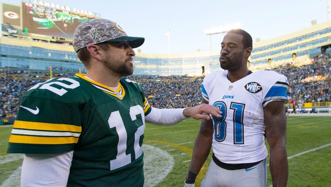 Nov 15, 2015; Green Bay, WI, USA; Green Bay Packers quarterback Aaron Rodgers (12) greets Detroit Lions wide receiver Calvin Johnson (81) following the game at Lambeau Field.  Detroit won 18-16.