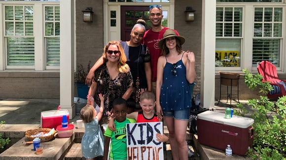 An Atlanta 6-year-old hosted a lemonade stand to raise money for immigrant children separated from their parents at the border. Several community families helped. The stand raised $13,000.