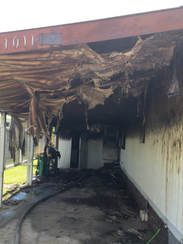 A single-wide mobile home caught fire Saturday morning