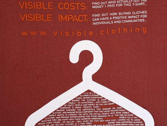 The back of a Visible Clothing T-shirt displays a list