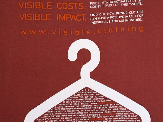 The back of a Visible Clothing T-shirt displays a list of the company's core social values.