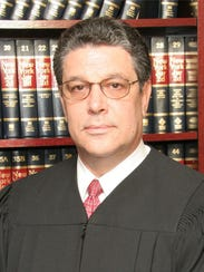 State Supreme Court Justice Lewis Lubell dismissed