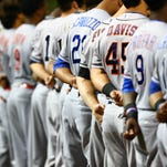 Baseball players line up during the national anthem prior to the Arizona Fall League Fall Stars game at Salt River Fields in Phoenix on Saturday.