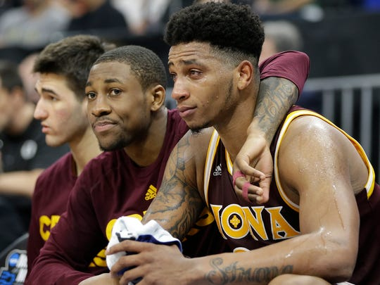 Iona's Rickey McGill center, and Jordan Washington,