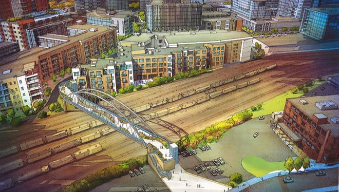 "The latest rendering of a planned pedestrian bridge connecting the Gulch and SoBro neighborhoods shows an arch design. Public Works officials say it is a ""starting place"" for discussion on a final design."