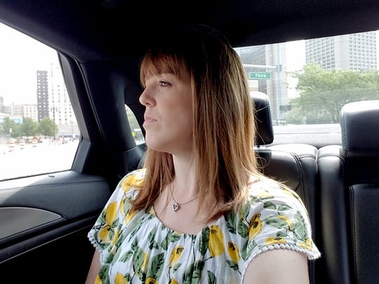 Detroit Free Press web producer Elissa Robinson rides in an Uber towards the DIA as part of the Free Press' Great QLINE Race in Detroit last month.