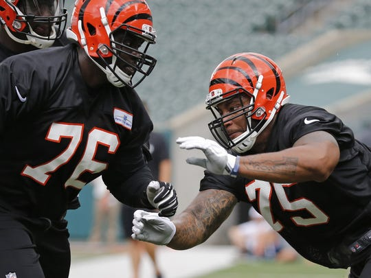 Cincinnati Bengals tackle Matthew O'Donnell (76) and Devon Still (75) run through a drill.