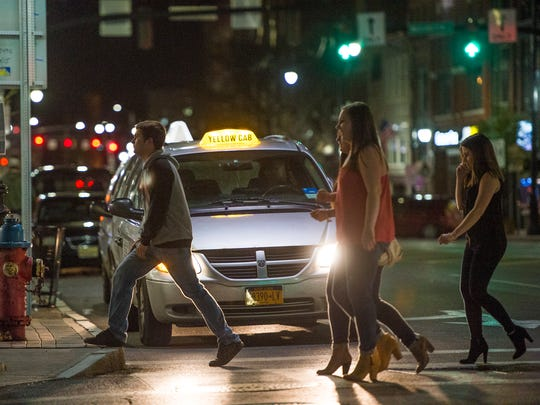A cab waits for passengers on Court Street late on
