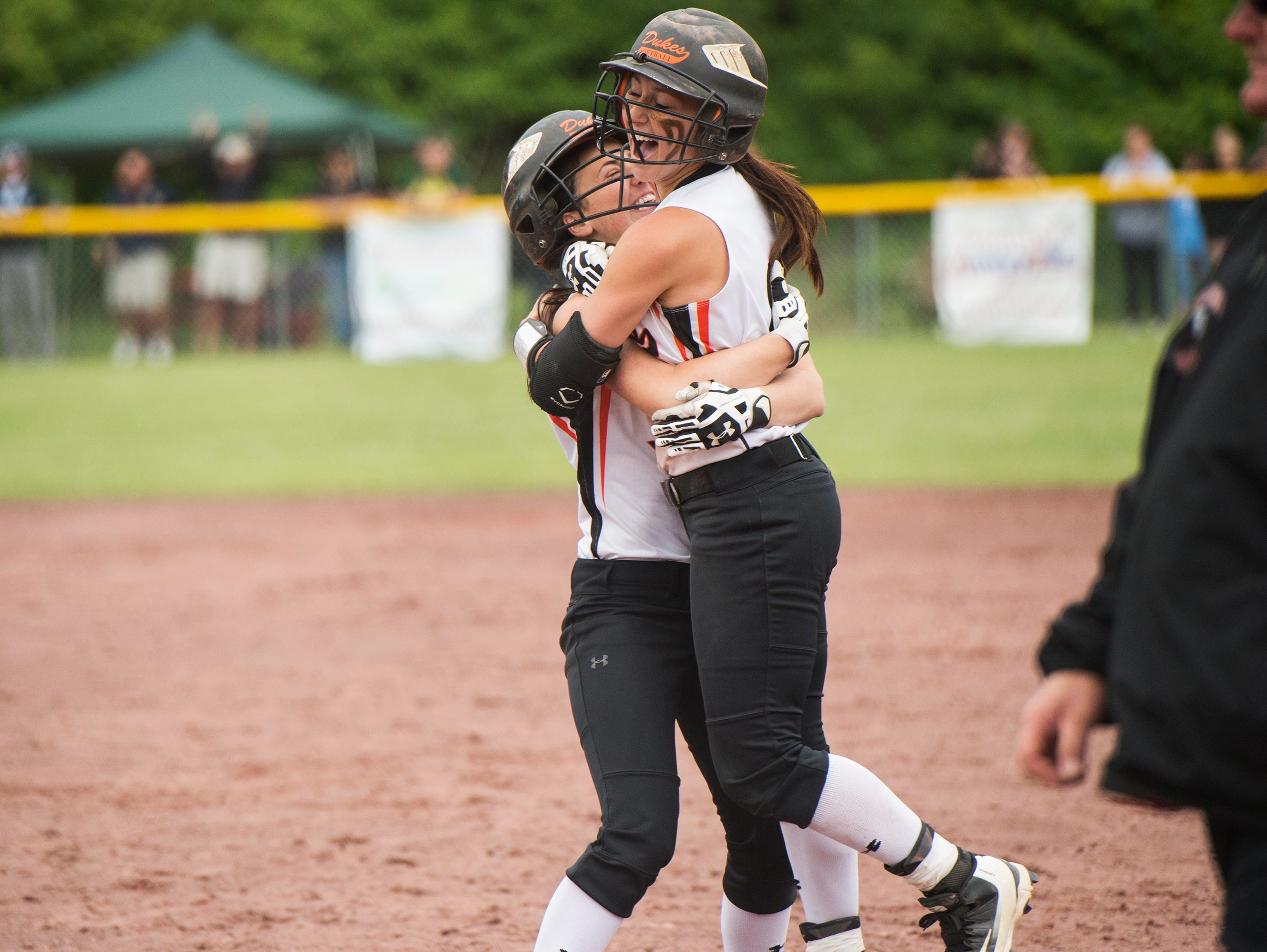 Marlboro High School's Taylor Felicello, left, hugs Ashley Votta after Votta hit the game-winning single in the bottom of the seventh inning in the Class B state title game against Windsor on June 12 in South Glens Falls.