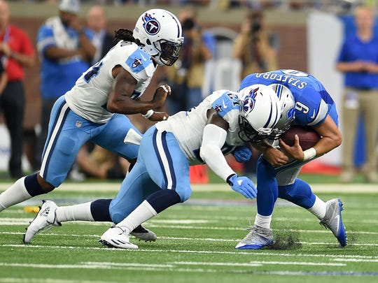 Titans safety Da'Norris Searcy hits Lions quarterback Matthew Stafford during the first half of a game at Ford Field on September 18, 2016 in Detroit.