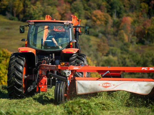 Peter Reynolds uses a tractor to cut hay Wednesday on his Glen Aubrey farm. A lack of rain fall over the summer stunted hay growth and delayed the harvesting process.
