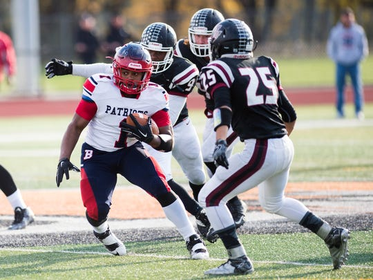 Binghamton's Matt Collins-Pringle rushes the ball against Elmira during the second quarter of  the Class AA title 36-28 in overtime on Saturday, Nov. 5, 2016.