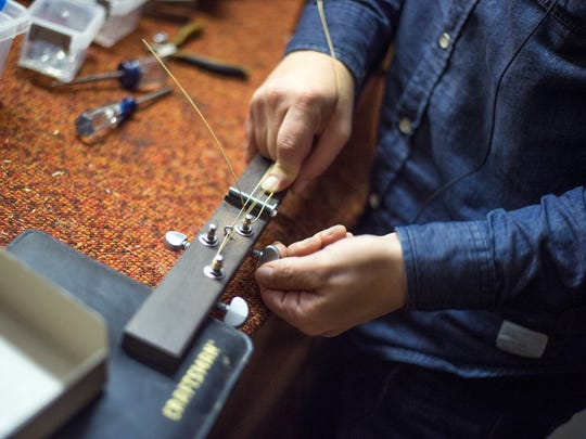 Fletcher has been making the cigar-box guitars by hand