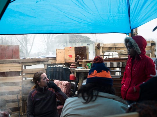 From left, Lisa Walinske, attorney and organizer, talks to Jasmine Franklin (on right), law clerk, both of ReDetroit East NPO, on Monday, Dec. 4, 2017 at Walinske's makeshift shelter in Detroit.