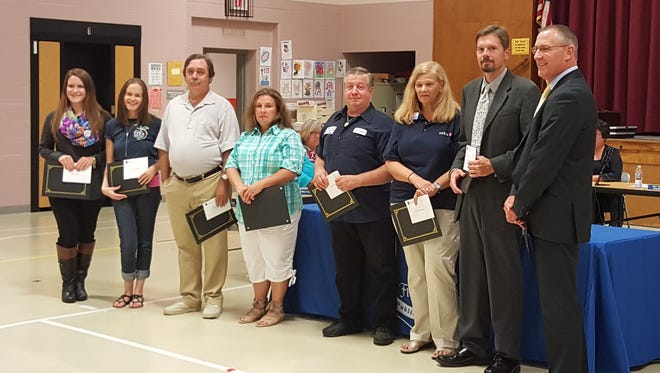 (From left) Danielle Teti, Jami Centrella, Andrew Jones, Lori Halikman, John Sweeney, Kathleen Higginson, Henry Kobik and Troy Walton were among the staff members recognized by the Township of Franklin Board of Education for perfect attendance during the 2014-2015 school year.