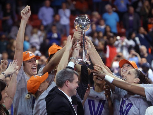 WNBA FINALS | Game 3 in Chicago -- Mercury 87, Sky 82: Phoenix celebrates after finishing off a three-game sweep of Chicago to clinch the third WNBA championship in team history.