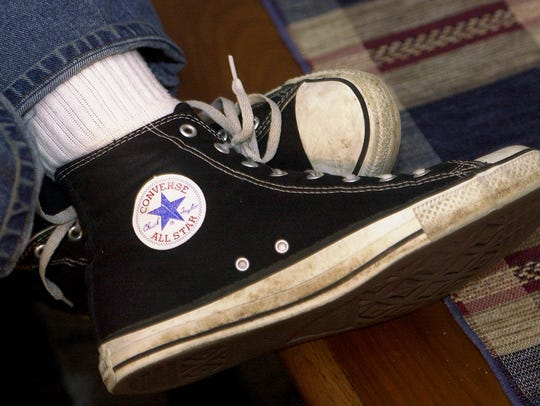 Chuck Taylors, black high-tops. Note Mr. Taylor's signature