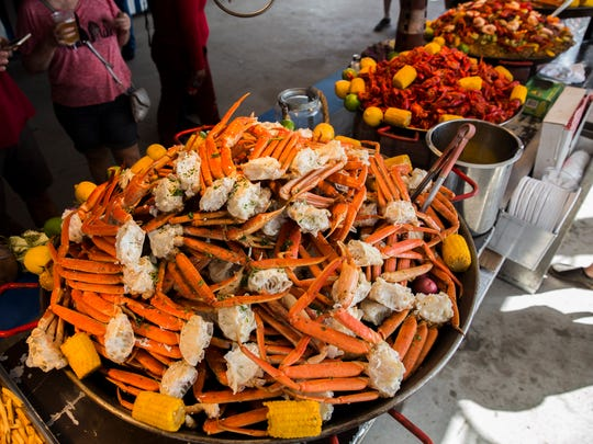 King crab legs, crawfish and mixed seafood sit on display