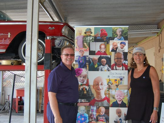 Mike Case, president of Classic Auto Restoration Inc., and Robyn Glazer Milbury, Esq., development and planned giving officer of the Progeria Research Foundation, Inc.