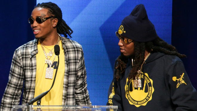 "Members of Migos look on during Michigan's ""Signing of the Stars"" on Feb. 3, 2016, in Ann Arbor."