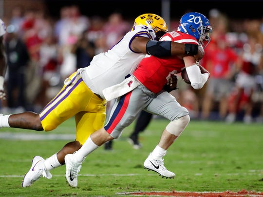 LSU defensive end Frank Herron (97) sacks Mississippi quarterback Shea Patterson (20) in the first half of an NCAA college football game in Oxford, Miss., Saturday, Oct. 21, 2017. (AP Photo/Rogelio V. Solis)