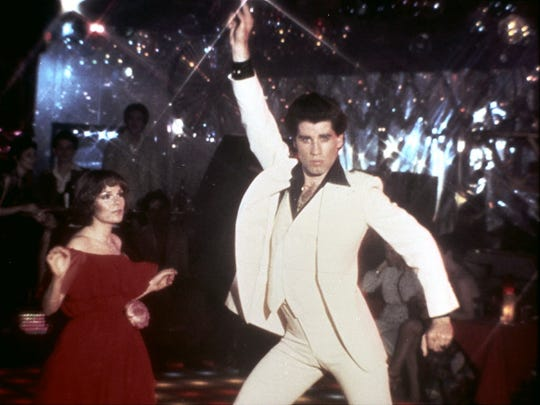 John Travolta (with Karen Lynn Gorney) struck a pose