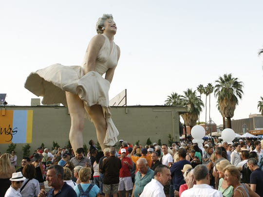 "Hundreds of people gather around ""Forever Marilyn,"""