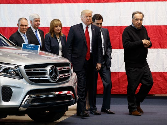 President Donald Trump tours the American Center of