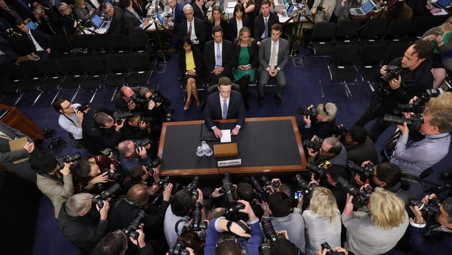 In this April 10, 2018, file photo, Facebook CEO Mark Zuckerberg arrives to testify before a joint hearing of the Commerce and Judiciary Committees on Capitol Hill in Washington, about the use of Facebook data to target American voters in the 2016 election.