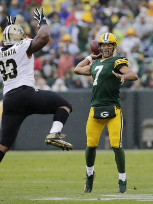 Green Bay Packers quarterback Brett Hundley (7) throws under pressure from New Orleans Saints defensive tackle David Onyemata (93) in the second quarter at Lambeau Field on Sunday, October 22, 2017 in Green Bay, Wis.  Adam Wesley/USA TODAY NETWORK-Wisconsin