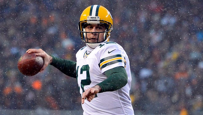 Green Bay Packers quarterback Aaron Rodgers (12) drops back to pass against the Chicago Bears during the first quarter at Soldier Field.