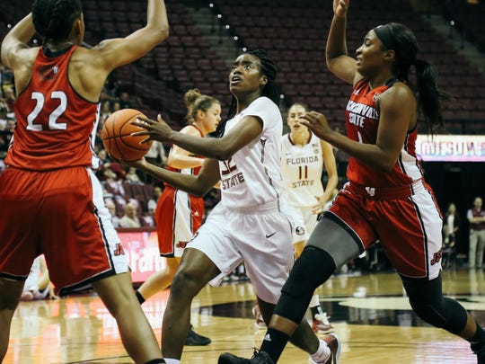 Imani Wright (32) drives to the basket against Jacksonville