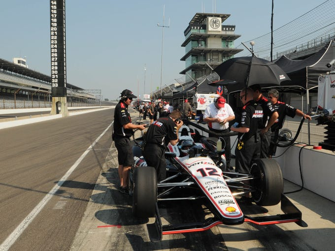 The Penske Racing team wok on the car of Will Power, while tire  testing Indy Cars Tuesday, Sept 10 2013 at The Indianapolis Motor Speedway.