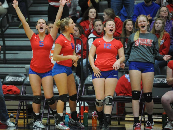 The Martinsville bench celebrates winning game one of the match. Avon and Martinsville met in an IHSAA sectional girls volleyball match at Brownsburg H.S. Thursday October 24, 2013. Rob Goebel/The Star.