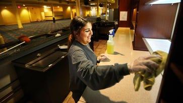 Dayley Acosta cleans the bar on the bottom floor of the former Rhythm City casino boat.
