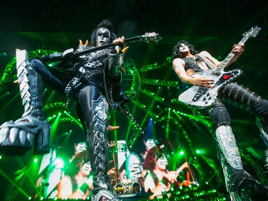Gene Simmons (left) and Paul Stanley performs with Kiss for fans at Ak-Chin Pavilion in Phoenix July 9, 2014.